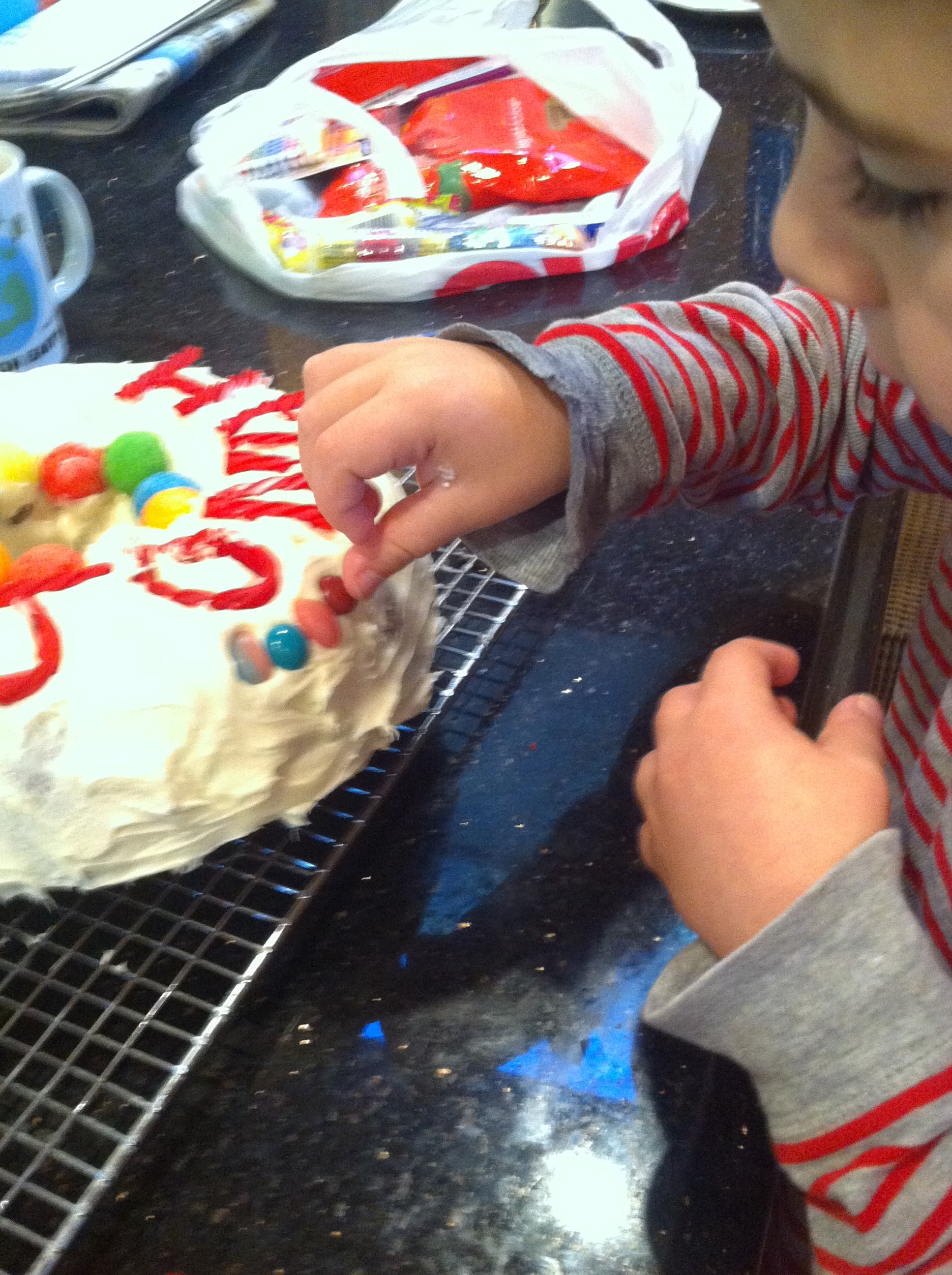 Jonah decorating the trial candy cake 2014
