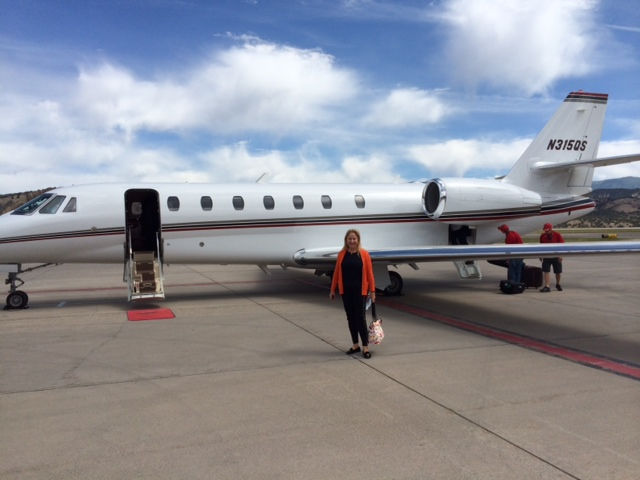 Larraine flying in Ginas jet home from funraiser 2014 in Vail