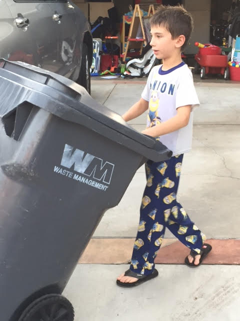 Jack taking out trash doing chores