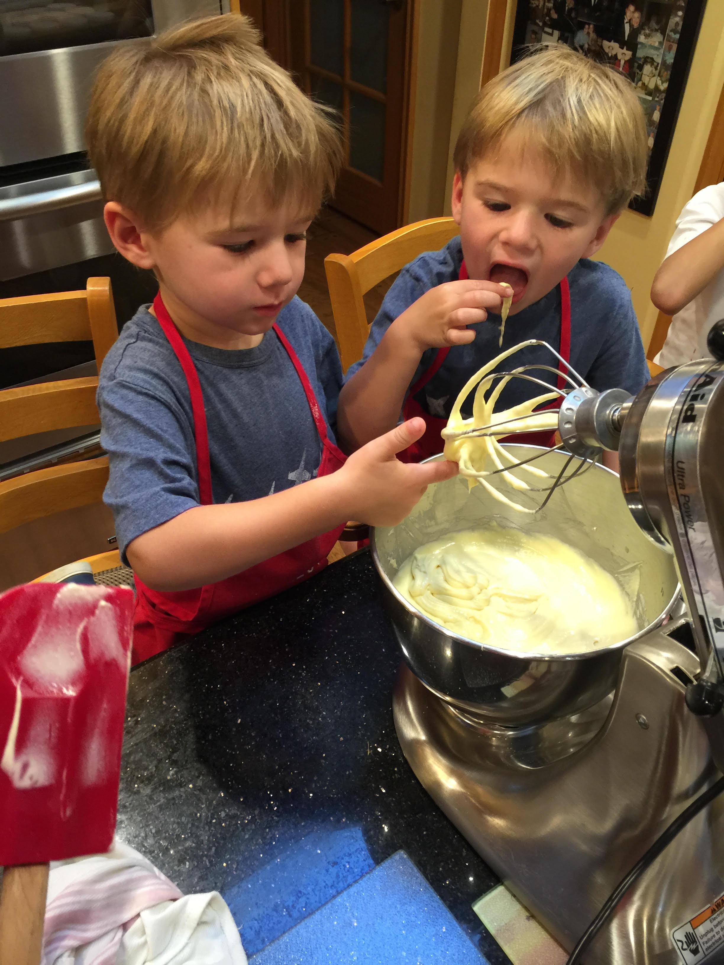NOah and Gabe tasting cupcake mixture