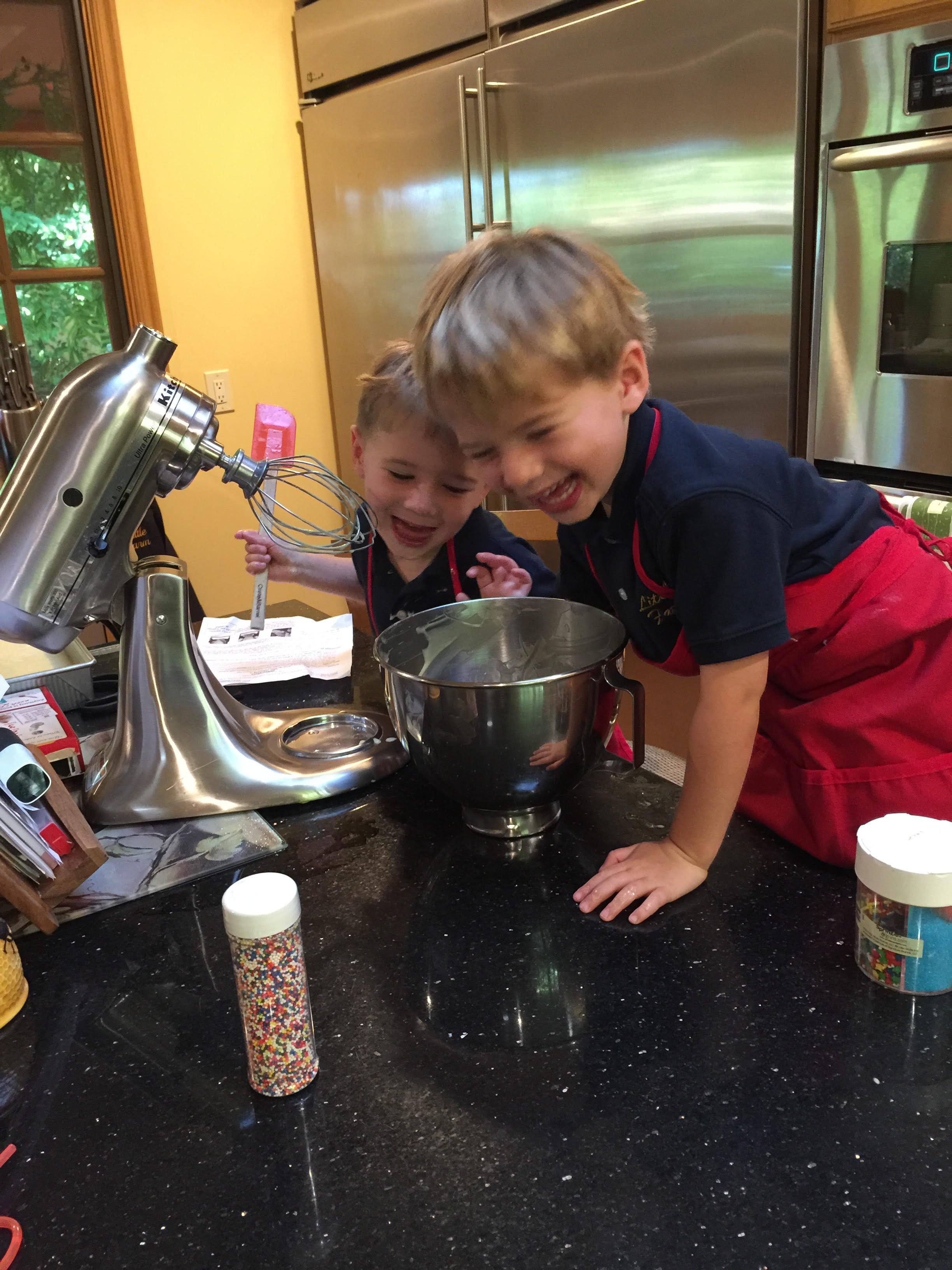 NOah and Gabe making a cake