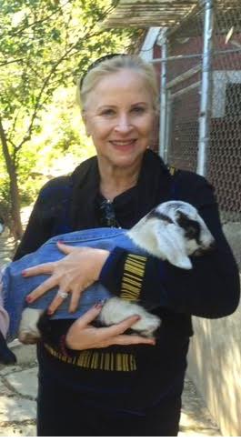 Larraine holding baby goat in denim Feb 2016